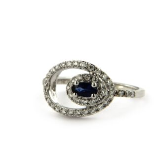 White gold ring with diamonds and sapphire 32939 01